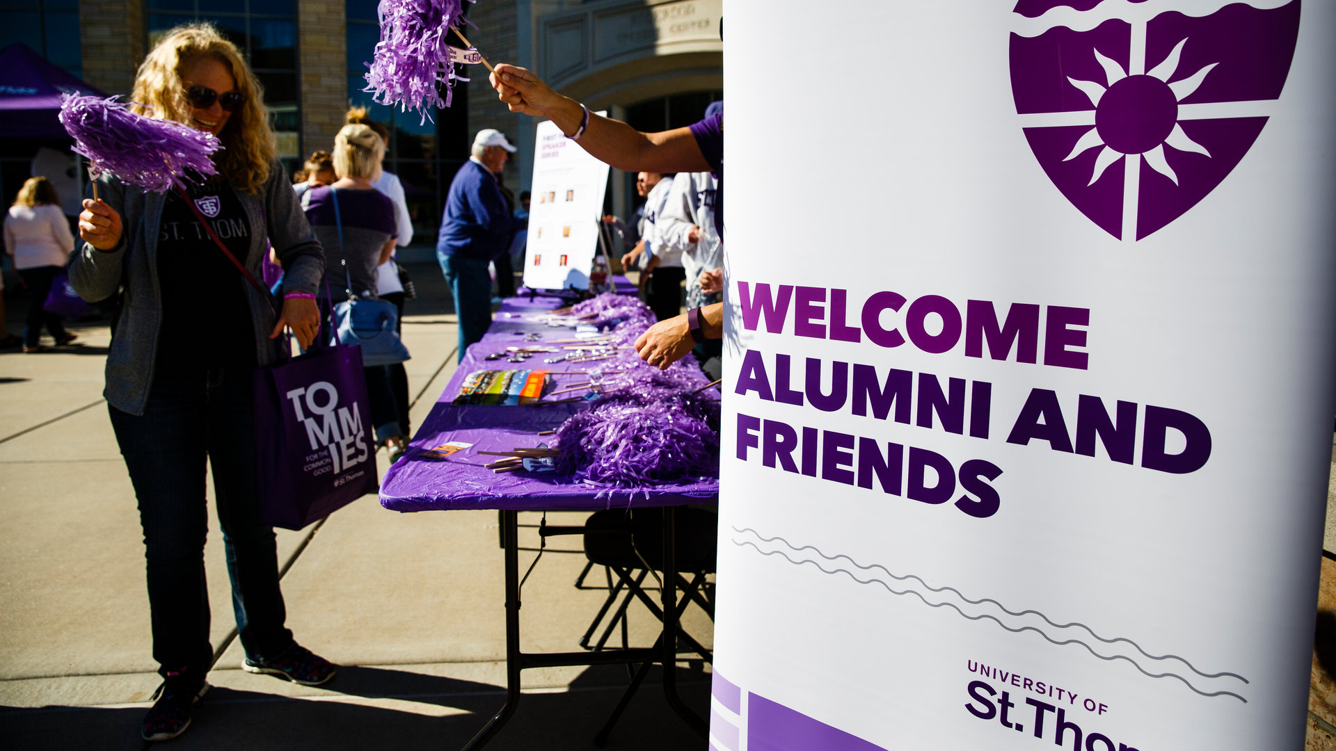 welcome alumni and friends sign on monahan plaza at homecoming