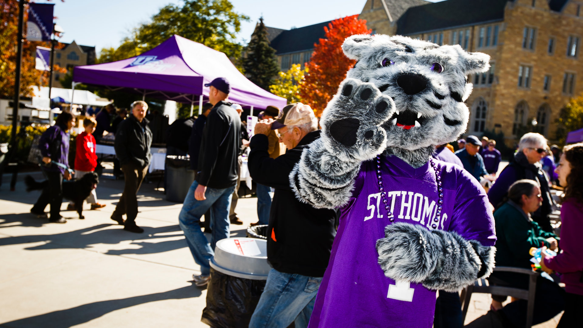 Tommie waves a the camera during an event on campus