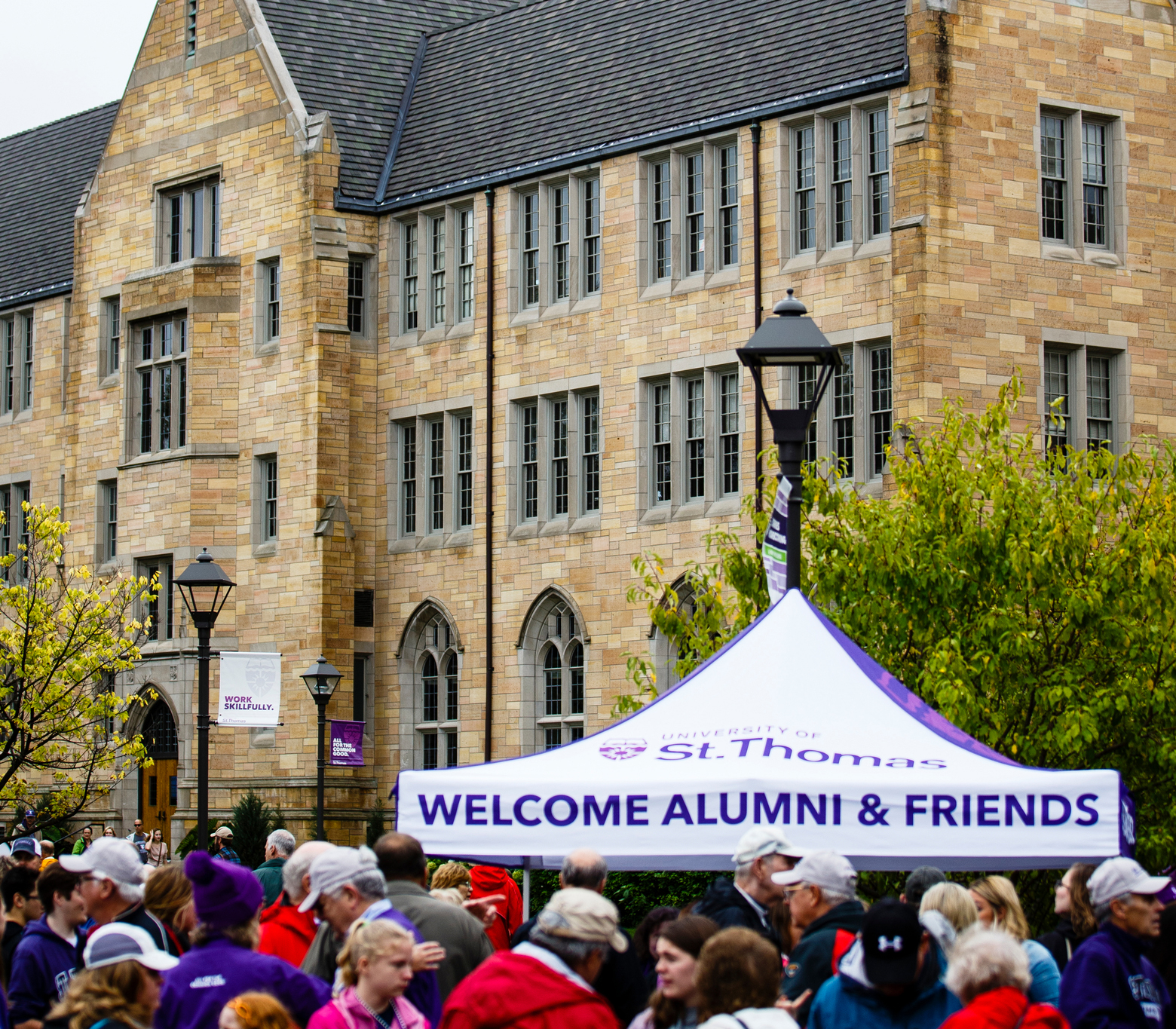 alumni tent in homecoming crowd