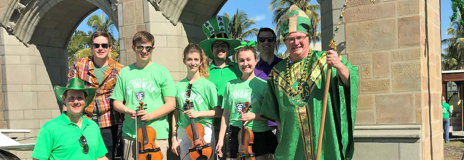 students and professors dressed in green for Naples St. Patrick's Day parade