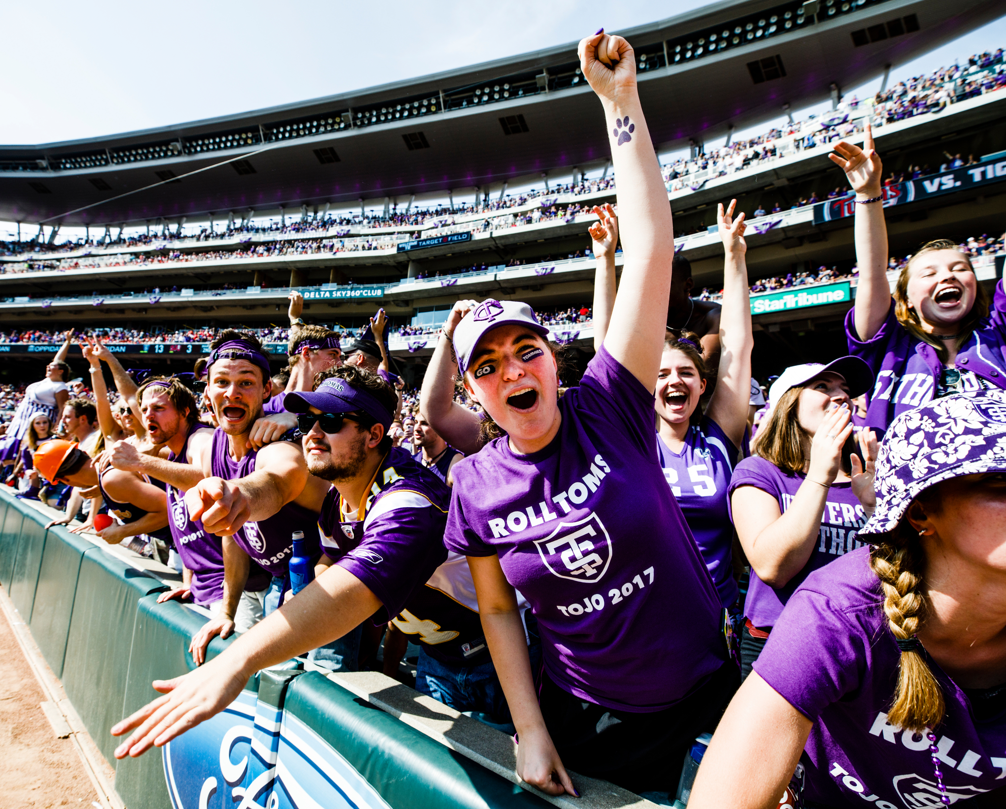 students celebrate at the 2017 tommie johnnie football game at Target Field
