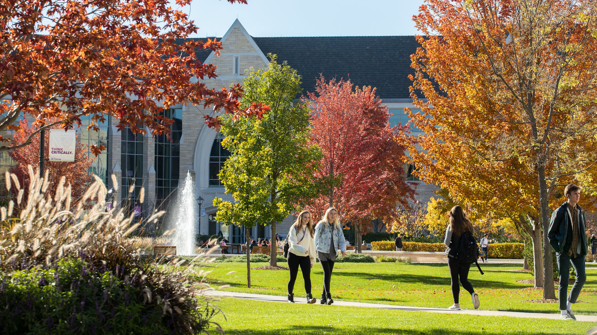 students walk around campus during the fall
