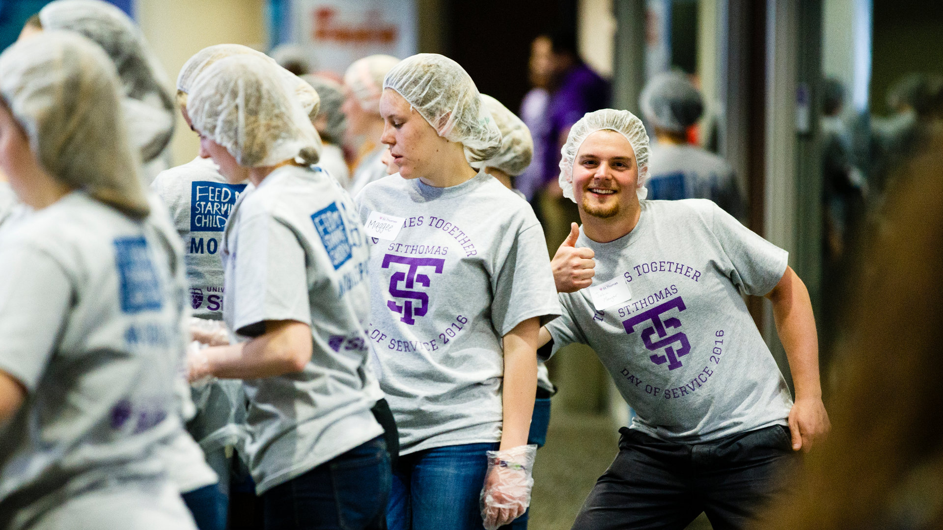 A culture of service starts with the students (shown here packing meals for Feed My Starving Children), who then continue to serve as alumni.
