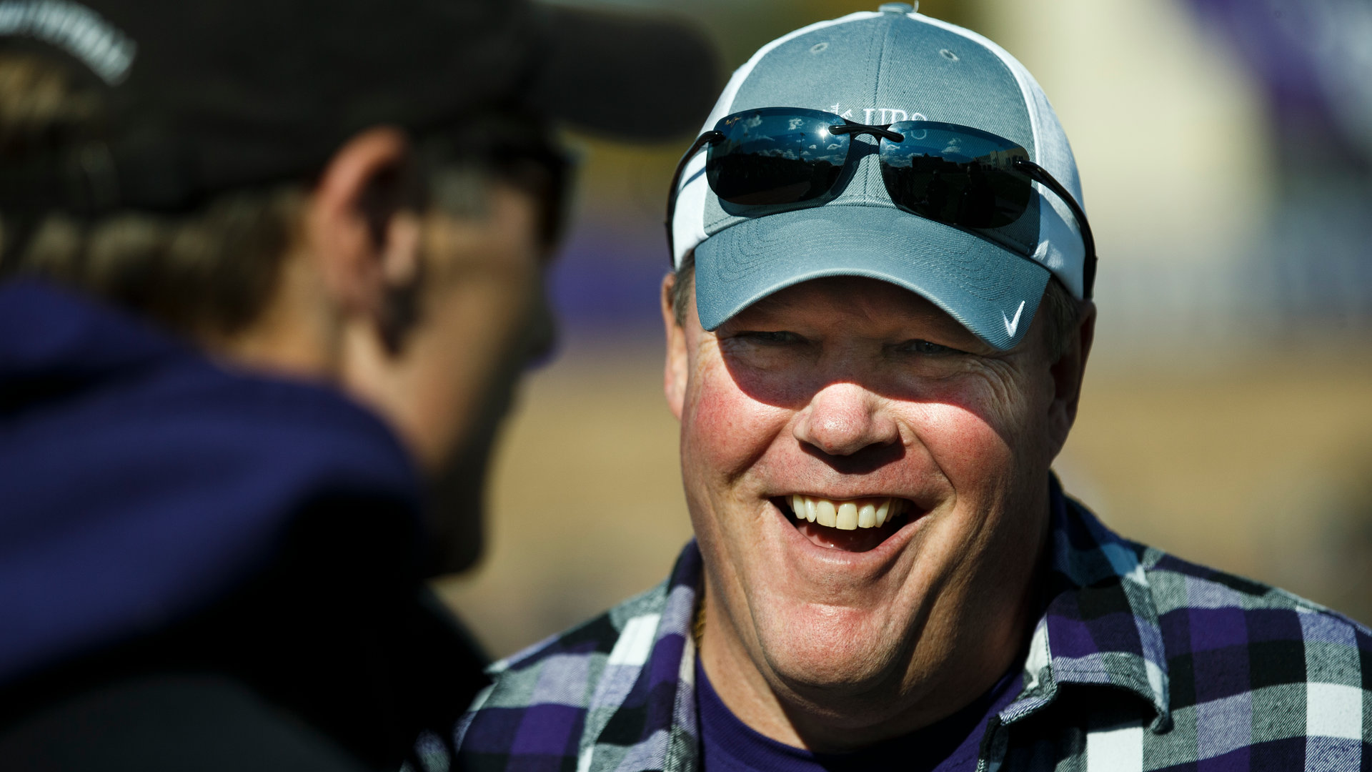 Alum Chip Connelly laughs as he is honored at half time of a football game against Bethel University October 24, 2015 at O'Shaughnessy Stadium.
