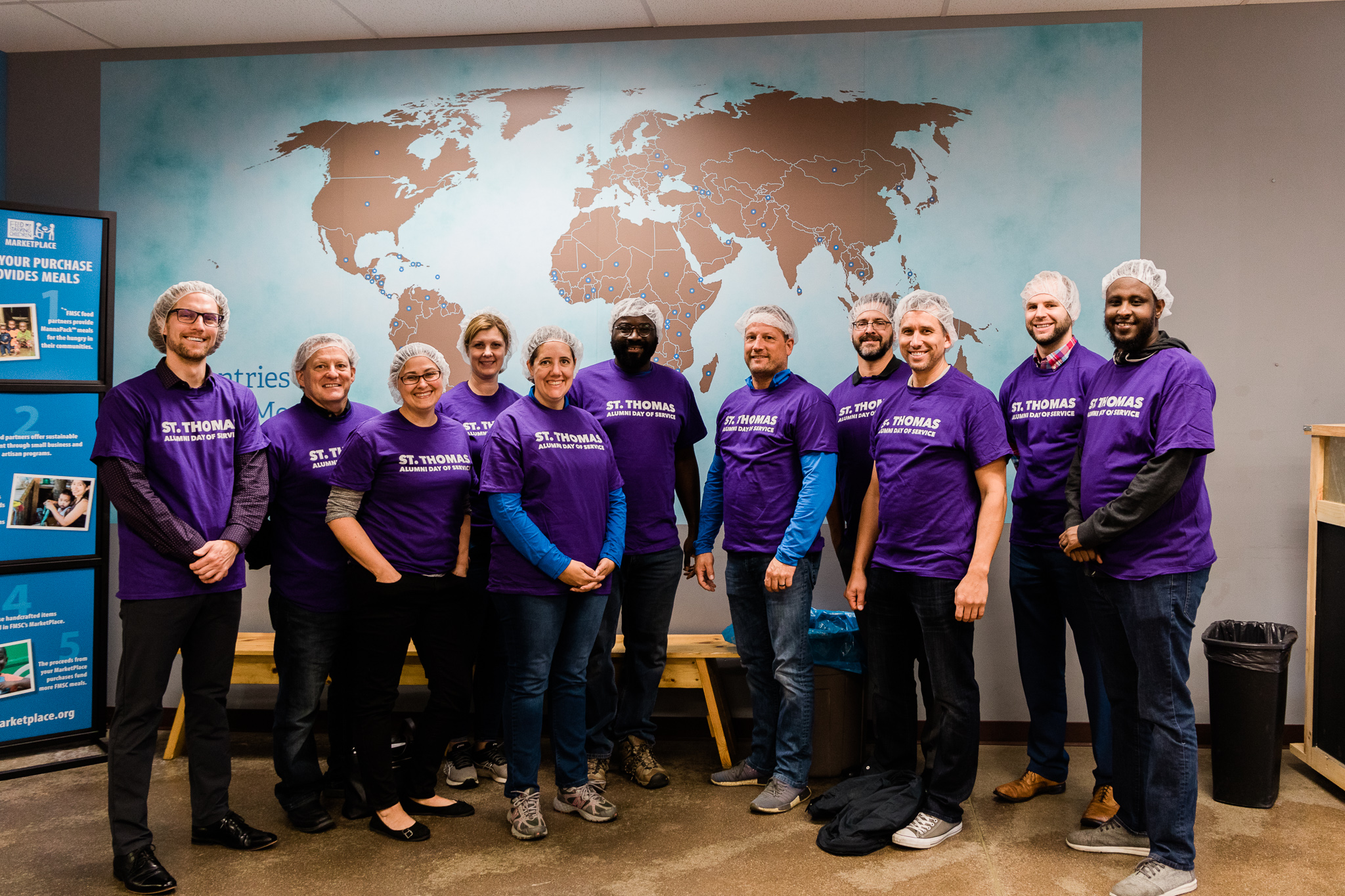 3m employees pose for a picture at Feed My Starving Children