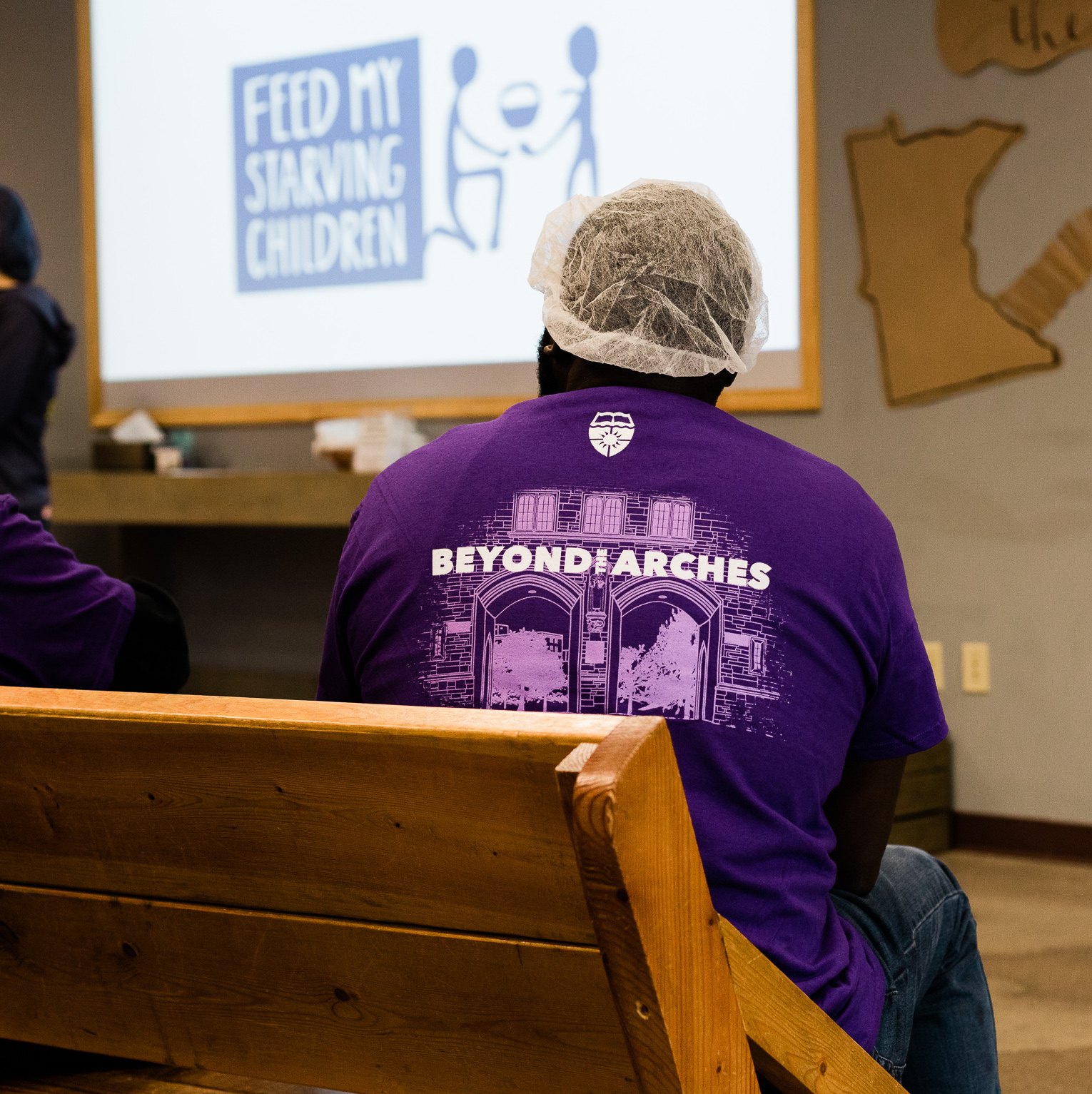 a 3M employee watches a demonstration at a Feed My Starving Children event