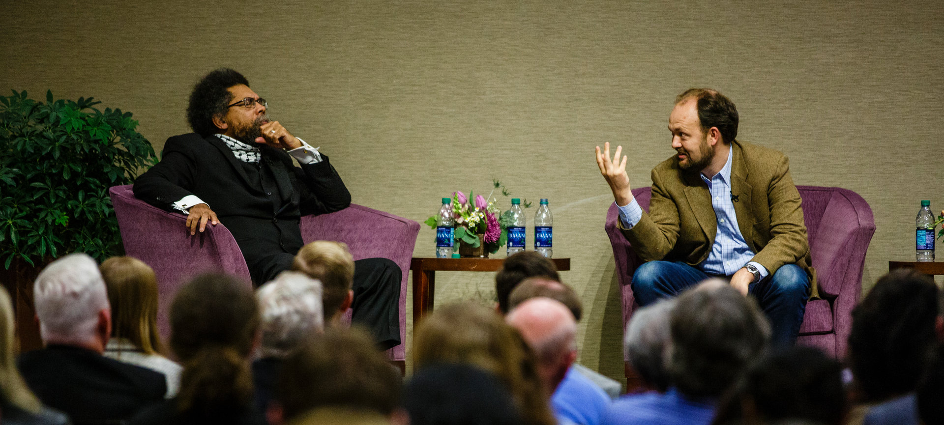 cornel west and ross douthat speaking on a panel
